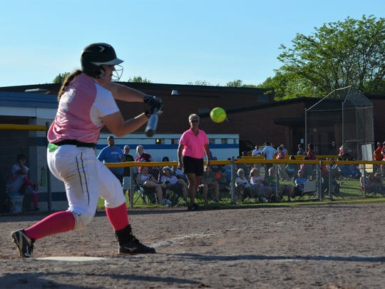 Pennfield's Kaylee Clothier takes a swing during the All-City softball tourney.