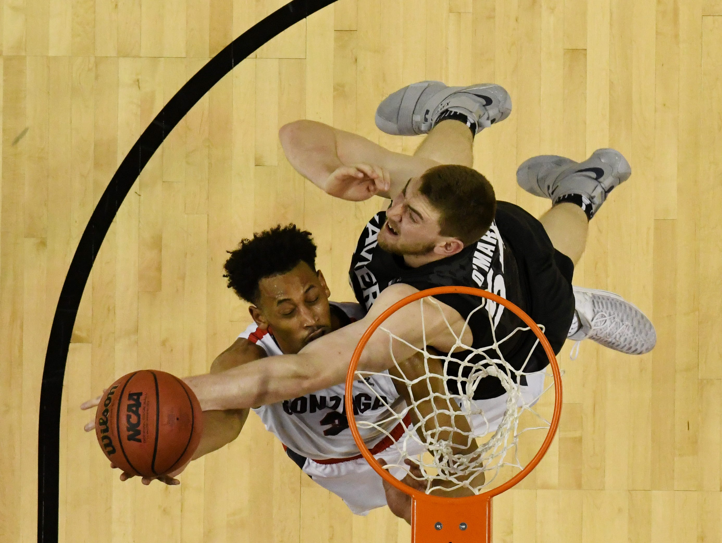 Gonzaga Bulldogs forward Johnathan Williams (3) shoots against Xavier Musketeers forward Sean O'Mara (54) in the finals of the West Regional of the 2017 NCAA Tournament at SAP Center.
