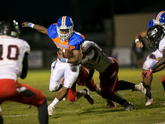 Rickey Anderson runs the ball for Cape Coral against