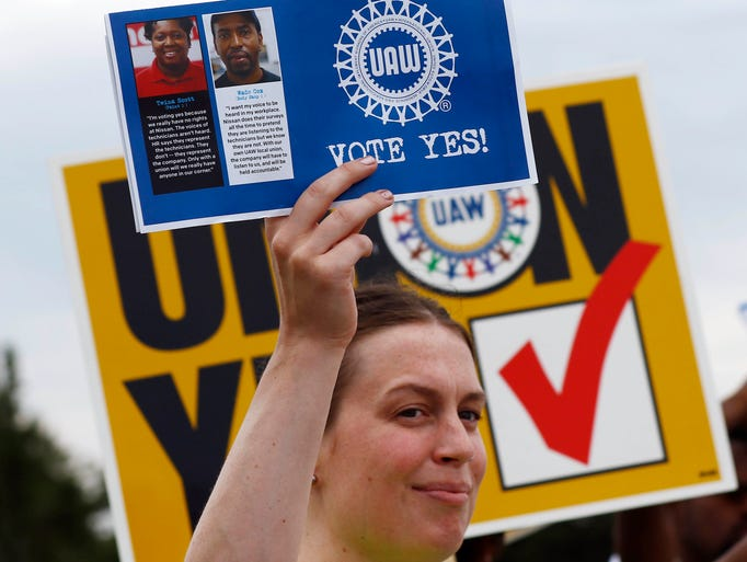 In this Tuesday, Aug. 1, 2017, photo, a UAW member