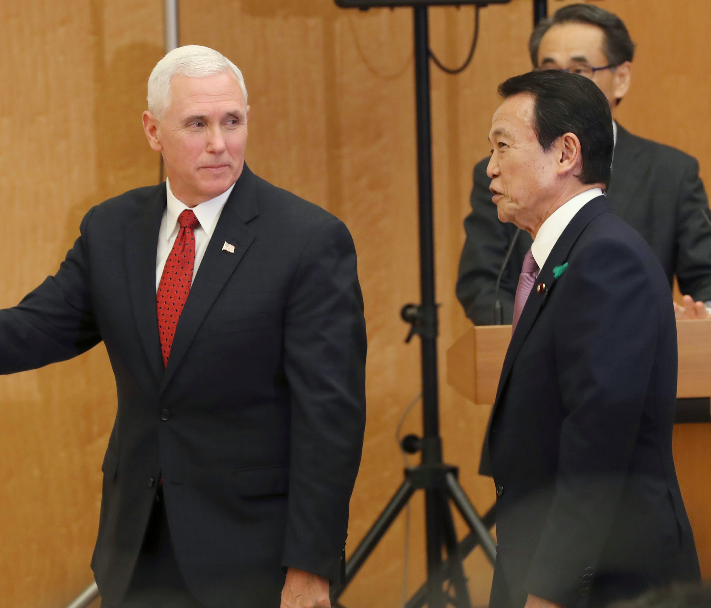 Vice President Mike Pence and Japanese Deputy Prime Minister and Minister of Finance Taro Aso walk in the venue of the joint press conference at the prime minister's office in Tokyo, Tuesday, April 18, 2017.
