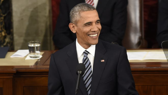 President Obama smiles during the State of the Union Address Tuesday night.