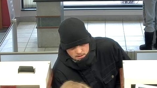 Police say a suspect has been arrested in the Jan. 11 robbery of Bank of America in Genoa Township.