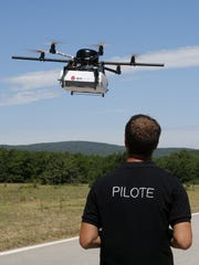 Benoit Leroux, drone pilot at DPD Geopost, directs