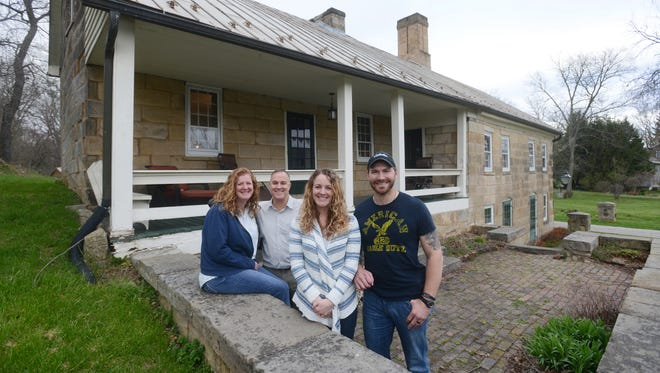 Carrie and Brian Adams, left, and their daughter Ashley Ensley and her husband Cody are opening the Headley Inn as a bed and breakfast and location for weddings and events. The property includes the original Headley Inn, a log cabin and a new pavilion.