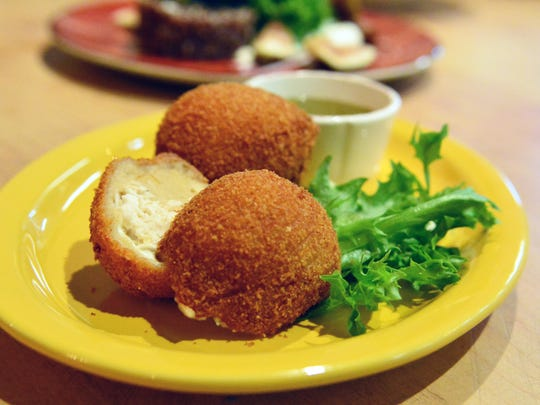 Coxinhas, Brazillian chicken croquettes, are on the