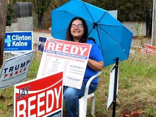 Republican Jay Reedy supporter Beth Garza sits outside