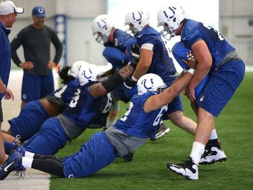 The Indianapolis Colts held final day of minicamp Thursday, June 19, 2014, afternoon at the Colts Complex in Indianapolis. The offensive line goes through drills during camp. Matt Kryger / The Star