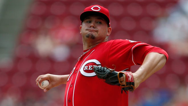 Cincinnati Reds starting pitcher Sal Romano throws against the Miami Marlins during the first inning of a baseball game, Sunday, July 23, 2017, in Cincinnati.