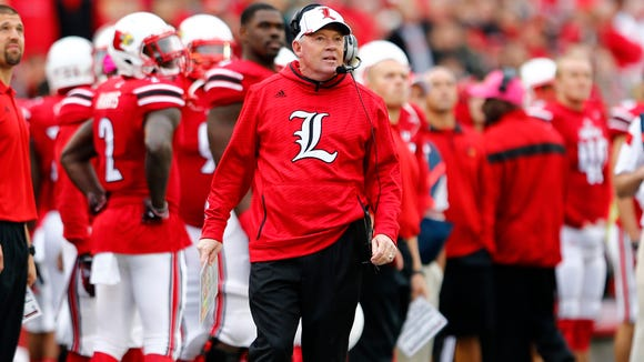 University of Louisville head coach Bobby Petrino reacts top his teams play against the N.C. State's defense during the second half of play at Papa John's Cardinal Stadium in Louisville, Kentucky.       October 18, 2013