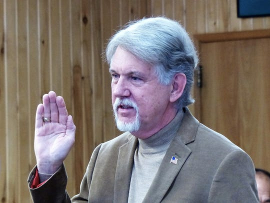 Dr. Gary Jackson raised his hand for the oath. He was