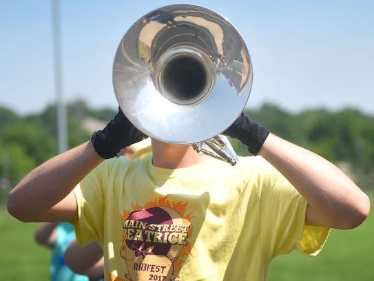 Alex Peters, junior, practices marching with his mellophone