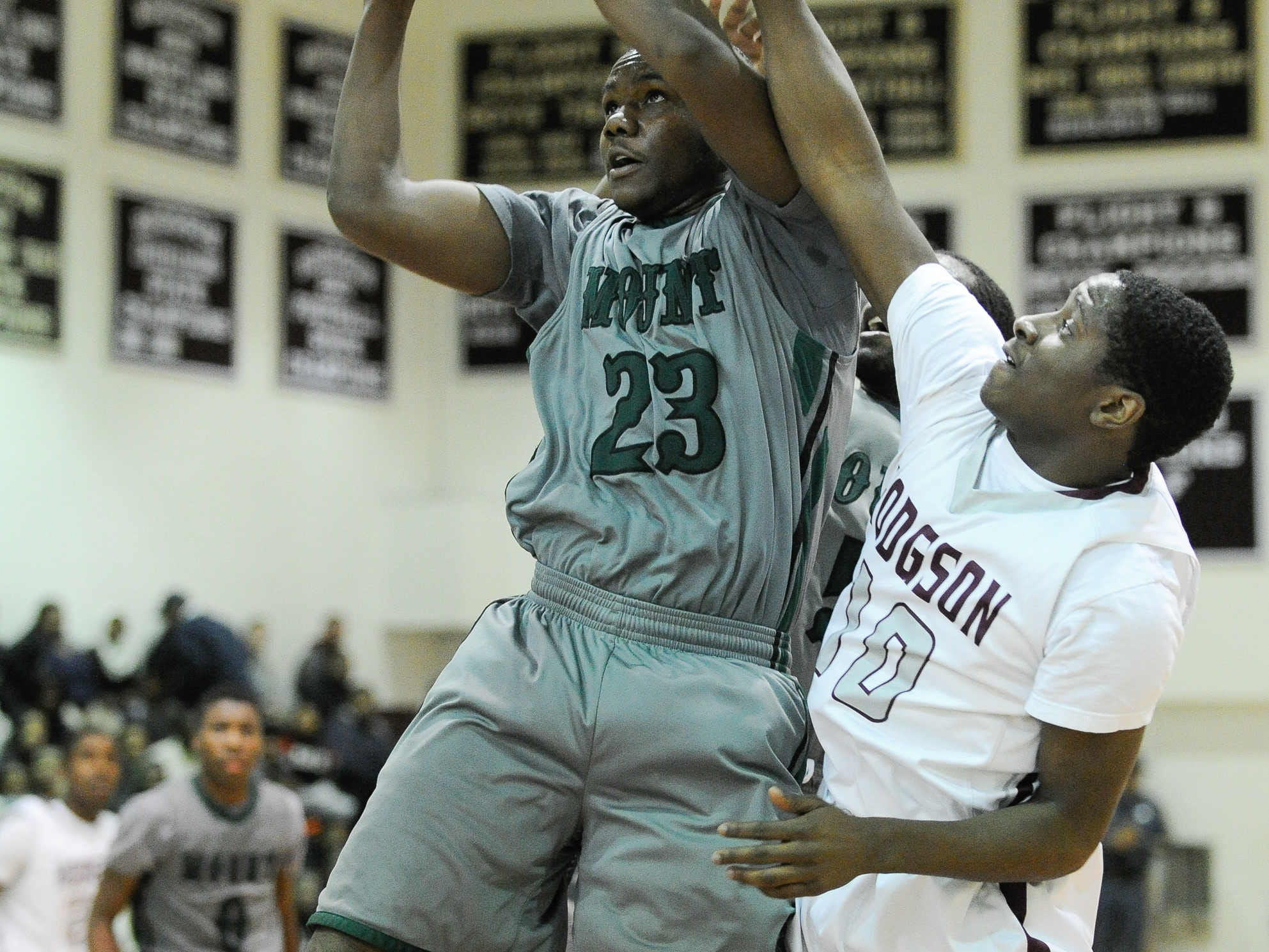 Mount Pleasant's Ronald Shipman-Scott goes in for a layup as Hodgson's Gregory Tucker tries to stop him.