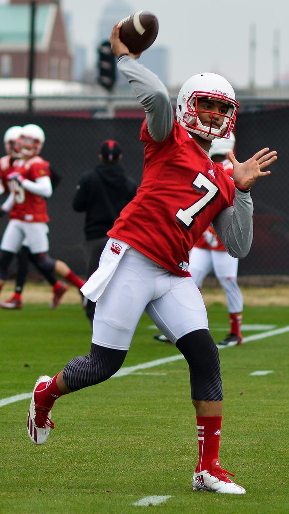 Quarterback Reggie Bonnafon, right, runs through drills