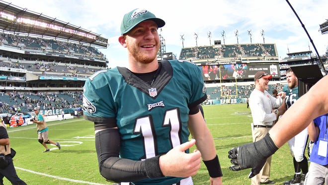 Carson Wentz is congratulated after a successful debut in which he threw for 278 yards and two touchdowns.