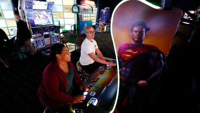 Felecia Wellington Radel and Alex Biese from the Fan Theory podcast play Injustice Arcade as they visit the new Dave and Buster's location in Woodbridge, the first of the chain's restaurant/arcades to open in New Jersey. November 9, 2017. Woodbridge, New Jersey