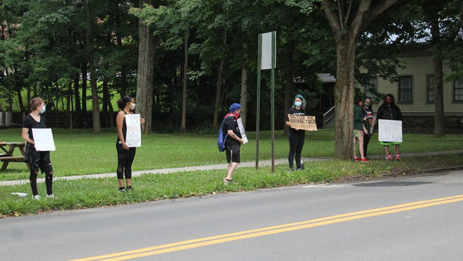 Protesters lined the streets of Alfred on Saturday morning. Sean Curran/The Spectator.