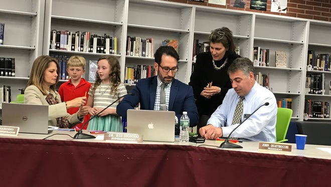 Verona students help school district officials with their challenge during an April 18, 2017 Board of Education meeting.