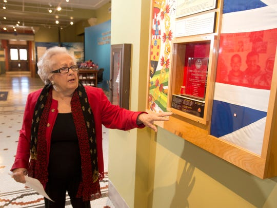 Maria Davis, Spanish consul, checks out some of the Spanish items on display at the T.T. Wentworth museum before Thursday's unveiling of a painting to honor General Bernardo de Galvez.