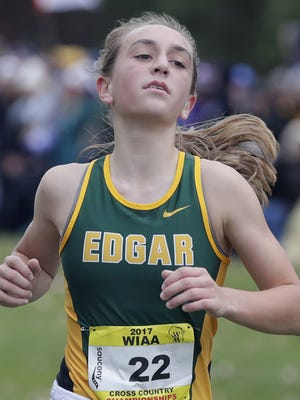 Marissa Ellenbecker won the Division 3 girls race during the WIAA state cross country meet Saturday. She became only the second runner in the Edgar girls program history to win an individual title.