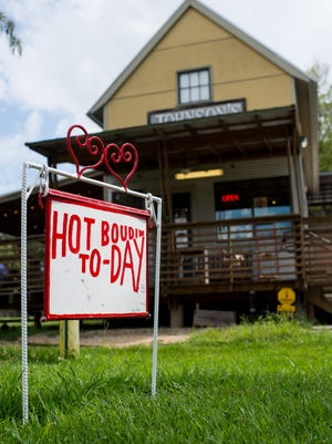 A sign at the front of Johnson's Boucaniere in Lafayette, La., advertises hot boudin at the business on Tuesday, Sept. 29, 2015.