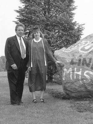 Frank Line and his daughter Emily at her graduation from Marshall High School in 1996.
