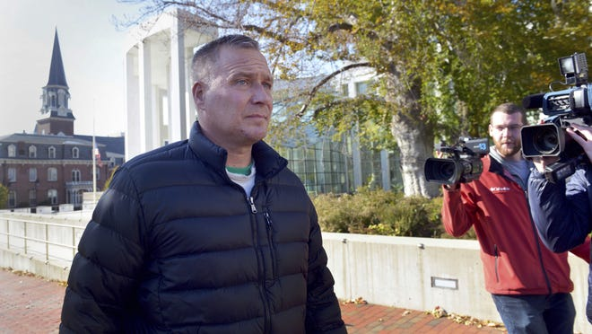 """Former Springfield police detective Steven Vigneault leaves the Springfield federal courthouse Wednesday in Springfield, Mass. Springfield police Officer Gregg Bigda and former detective Steven Vignault, two police officers used excessive force while arresting two Latino teenagers, and one of the officers said """"welcome to the white man's world,"""" according to a federal indictment unsealed in Massachusetts."""