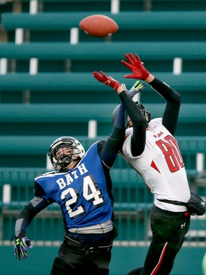 Class C football State quarterfinals - Bath's Noah Hockaday breaks up a pass intended for Maple Grove's Pat Nelson to keep the score at 8-8 for the end of the second quarter at Sahlen's Stadium.