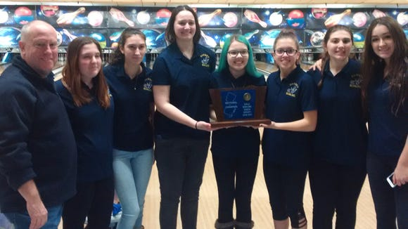 Led by BCWCA Coach of the Year Bill Chesney (left), the Ramsey girls bowling team won its first North Group 1 title this season.