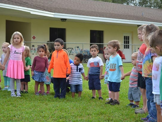 Students from the toddler and primary programs participate