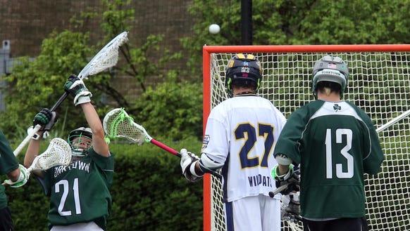 Yorktown's Liam Donnelly (21) blocks a shot during
