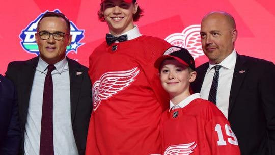 Steve Yzerman, left, drafted Moritz Seider at sixth overall in 2019. If the Detroit Red Wings pick fourth in 2020, Yzerman could well select another defenseman.