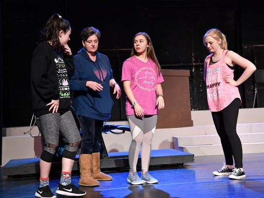 """Betty Hukill works with Madi Sipe (from left), Alexis Gomez and Madi Melbourne during rehearsal of the Paramount Theatre's production of """"Legally Blonde the Musical, Jr."""" in January. Hukill directed the winter show that featured an all-youth cast."""