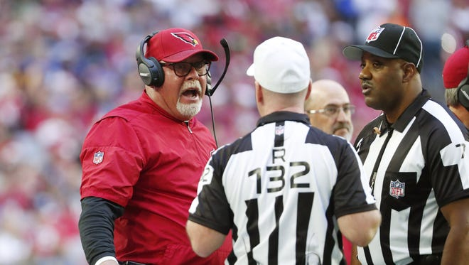 Arizona Cardinals head coach Bruce Arians talks with referee John Parry (132) during the second quarter against the New York Giants at University of Phoenix Stadium in Glendale, Ariz. December 24, 2017.