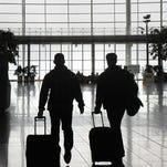 Travelers walk through the terminal at Indianapolis International Airport.