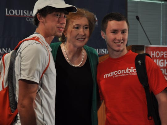 Posing with Janet Huckabee are Louisiana College students Cameron Townley (left), a freshman, and Bryce Glass, a sophomore.