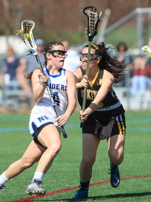 North Brunswick's Tory Tucci (4) is defended by South Brunswick's Rachel Hecht (3) on Tuesday, April 11, 2017 at North Brunswick.