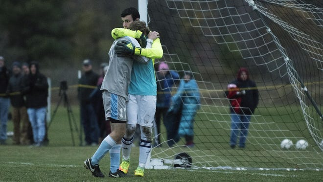 Essex goalie Paul Federico (right) consoles South Burlington's Patrick O'Hara after missing a penalty kick in the Division I high school boys soccer semifinals.