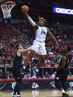 Nevada's Jordan Caroline drives to the basket during the Wolf Pack's win over Utah State. He finished with a team-high 22 points.
