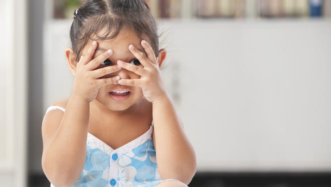Playing peekaboo with your child is a good way to enhance their language development.