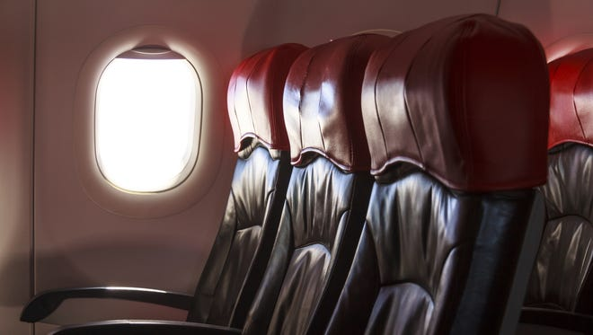 Stuck in the middle seat? Good manners can be an effective weapon against space invaders.