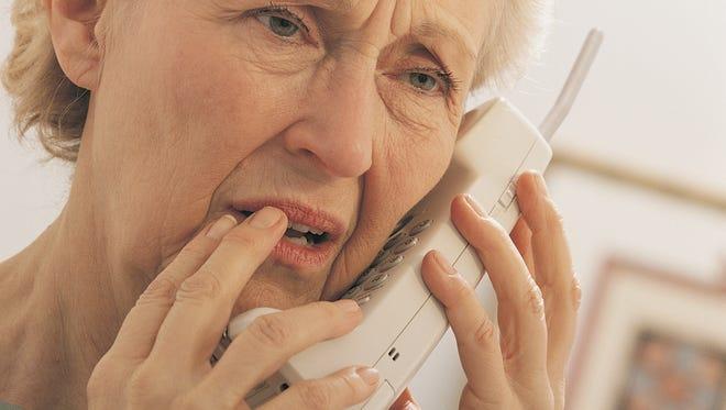 Worried woman on telephone