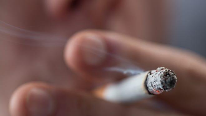 Focus on top of burning cigarette
