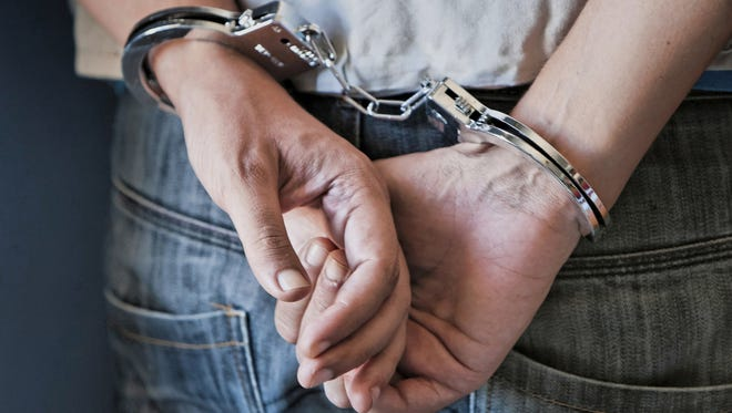 File photo of man wearings handcuffs