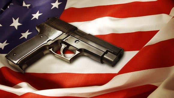 House panel approves welfare program for gun owners.