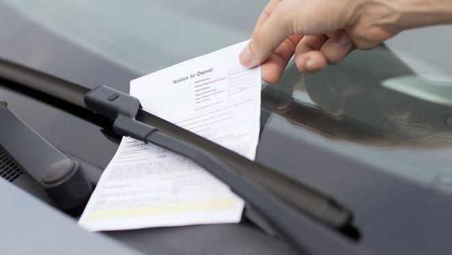 Parking ticket on car windscreen.