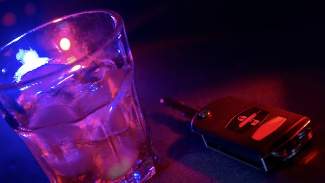 An illustration showing a drink and a car key.
