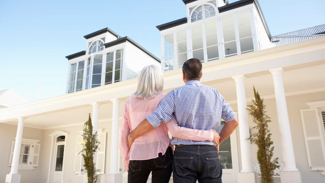 Experts say it might not be the wisest decision to splurge on an upscale home after retiring.