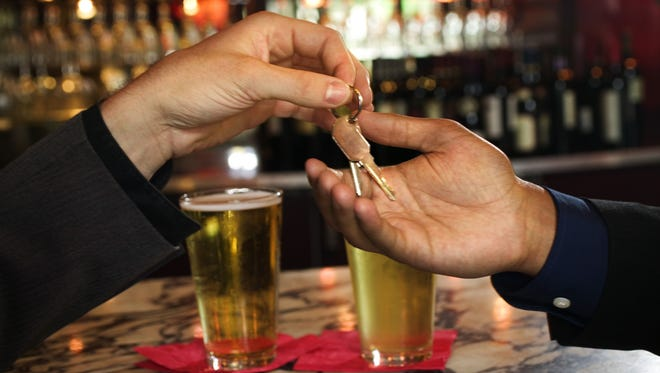 Hand of man giving car keys to designated driver