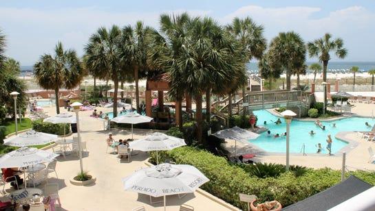 Rent a beach house -- or stay at Gulf-front Perdido Beach Resort.